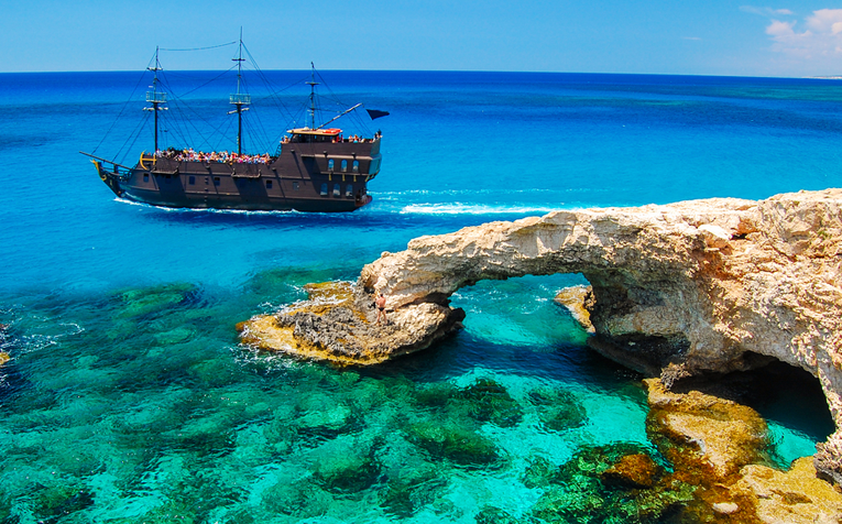 Pirate ship in crystal clear blue Cyprus sea