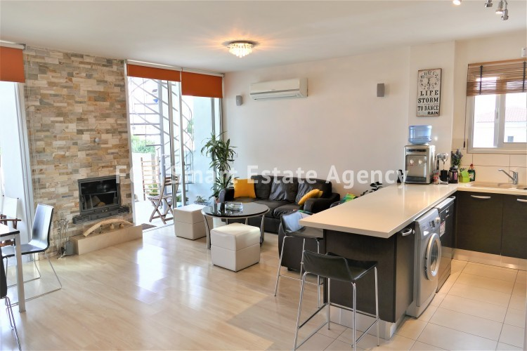 For sale 2 bedroom top floor apartment with roof garden and fire place in Acropolis
